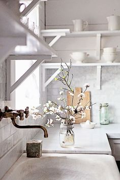 White farmhouse kitchen with open shelving and marble counters and backsplash - Farmhouse Kitchen Ideas & Decor
