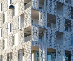 A total of 374 individual elements made of fibreC, covering over 2,000 square metres, go to make up the perforated skin of the HuttunenLipastiPakkanen Architects-designed Länsisatamankatu 23 apartment building in Helsinki's former docklands