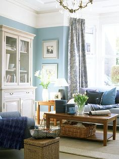 This bright blue paint is kept in balance by the use of white trim and decorative accents. The natural wood furniture and straw baskets also help ground the whimsical color. (Photo: IPC Images)