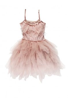 A blush pink full-skirted tutu dress. Cotton bodice has adjustable straps and is embellished with a necklace of sparkling beads, pearlescent discs, and soft feathers.