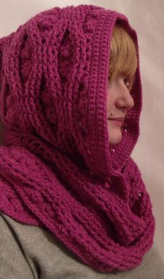 Cables and clusters combine, to make a hooded scarf/scoodie with a luxurious texture and touch-feely finish. Can be worked with/without the hood. easily modified for lighter weight yarns. #tcdesigns #crochet #mmmakers
