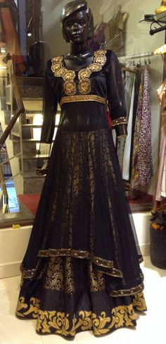 This velvet and brocade hand beaded black Anarkali is absolutely stunning in real. The blouse part is made of velvet while the rest is fine net.
