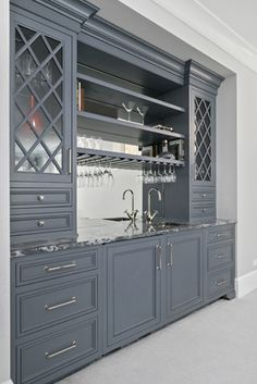 Mirror and glass to make a wet bar feel less heavy. Interior Design by Elizabeth Taich Design