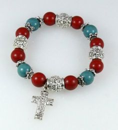 4030323 Cross Charm Christian Stretch Bracelet Silver Turquoise Coral Red Christian Bracelets. $9.99. Turquoise Silver and Coral Beads. Durable Construction. Christian Cross Charm Design. Beautiful Gift Box. Stretch for Comfort Fit. Save 44% Off!