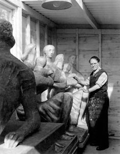 Henry Moore with casts of Family Group, 1948–9, in his studio at Hoglands, Perry Green, 1954. Photo by Ida Kar.