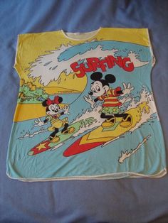 0f8f214d2b Mickey and Minnie Mouse vintage surfing t by midcenturymodernme