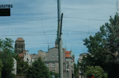 """Lots of cable car wires everywhere. Gdansk, Poland. Princess """"Star"""" Ship."""