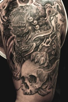 Half sleeve black and grey Foo Dog and Skull tattoo