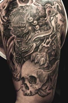 Half sleeve black and grey Foo Dog and Skull tattoo