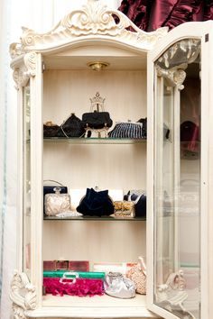 Store evening bag collection in pretty furniture.