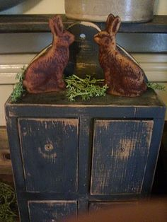 Primitive...Easter...old blue cupboard, 2 grungy rabbits...