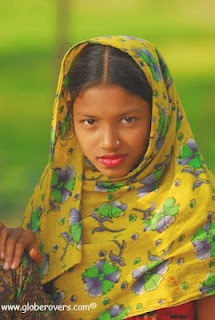This pretty and shy girl lives in the village of Bamrail (in Barisal District) along the Ganges delta of southern-central Bangladesh.  See my Bangladesh book here: http://www.blurb.com/bookstore/detail/2101626