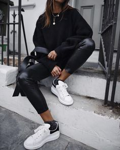 I love a chunky knit sweater with what look like Spanx faux leather  leggings and white Adidas or Nike tennis shoes. 443bbe18650d6