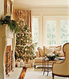 Mostly WHite!! WHite Wrapped Presents....This living room space exudes warmth and looks so beautiful for the holdiays--