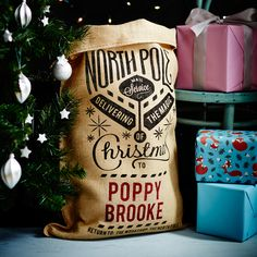 A Personalised Christmas Santa Gift Present Sack sprinkling of festive stars feature on this North Pole mail service message. Beautiful packaging