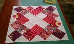 "Red Katie's choice block by bryanhousequilts, via Flickr  25"" using charm squares"