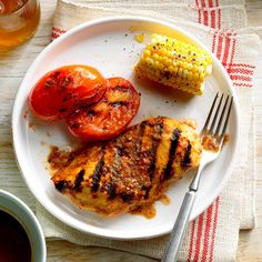 Grilled Basil Chicken and Tomatoes Recipe -Relax after work with a cold drink while this savory chicken marinates in an herby tomato blend for an hour, then toss it on the grill. It tastes just like summer. —Laura Lunardi, West Chester, Pennsylvania