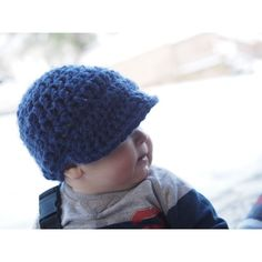 This chunky crochet visor beanie is a great little topper for the cooler weather Not only does it keep the child s head warm it is also a very stylin accessory! The cap is crocheted in an acrylic yarn which is washable and is featured in a shade of navy A great little topper for that snowsuit or winter
