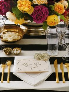 I like the bold colors contrasting with the awning stripes. The gold flatware looks great too!