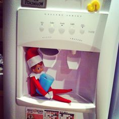 Elf on a Shelf - Who's thirsty? We have Elfie atSeasons by Design specialty shop, 2605 Ford Drive, New Holstein, WI 53061.       920-898-9081 Seasonsbydesigngifts@yahoo.com  Follow us on Facebook