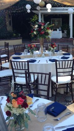The French Estate in Orange, CA. Flowers by 1 800 Rose Big in Newport Beach. Event coordinating by Simply A Soiree. Rentals by Baker Party Rentals in Costa Mesa. Music by Classic Image Mobile Music. Ivory tablecloth with burlap runner and navy napkins. Shabby chic.