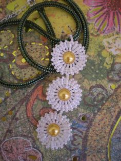 https://flic.kr/p/7NjbfN | Daisy Chain | I was asked recently to make a daisy necklace.  I made up my own bezelled rivoli design, but thought it might be too big so I decided to make this lovely design which was featured in the Oct/Nov 08 issue of UK Bead Magazine.  I had been looking for an excuse to try out one of Kerrie Slade's gorgeous designs! Created March 2010