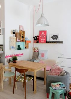Love the use of a kitchen table as a coffee table for a small space!