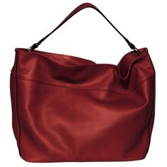 A rich, luxurious carryall that packs a practical punch. The Susan Bag features beautifully textured leather on the outside and interior organization sections for your accessories on the inside.Fully lined, its brightly colored ultra suede makes finding your keys a piece of cake, while oversized metal feet will protect against damp and rough surfaces.