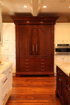 Custom panel integrated refrigerator armoire cabinet