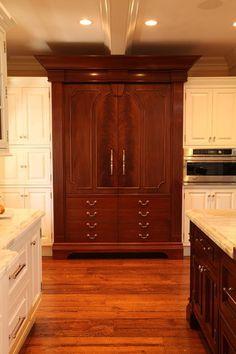 Custom panel integrated refrigerator armoire cabinet