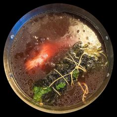 Part I: This looks gross... ...but this simmering cauldron of bone marrow broth #FishSauceForever & a poorly tied kombu bouquet garni by this here hack cook will be the base of ramen yumminess.  @graffiticookery  #RamenLife  #SDlife  #Slurp _ by marquisderad