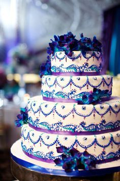 Fondant wedding cake with purple satin ribbon, black piped scrolls ...
