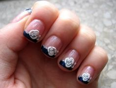 Here you can see a very cute short nail art design which uses basic pink nails and using some dark blue at the edges. To make the short nails really something special the extra decoration is a cute white unconventional heart.