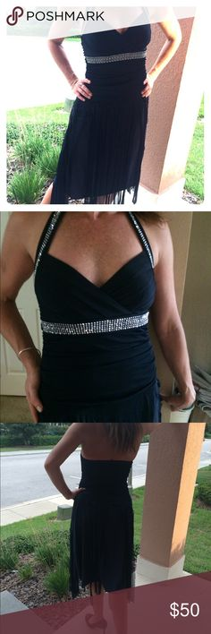 Flirty and flowing navy w/ rhinestones Extremely fun and comfortable navi with rhinestone trim around bodice and neck. Halter top with streamer skirt. Very playful but beautiful. Modesty pads. Trixxi Dresses