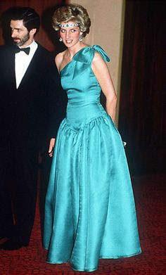 1985 | For an appearance in Melbourne, Australia, Diana accented a single-shoulder gown with an emerald-and-diamond choker worn as a tiara. The necklace was a wedding gift from the Queen, who likely imagined the deco treasure being worn in a more conventional way. | InStyle 7