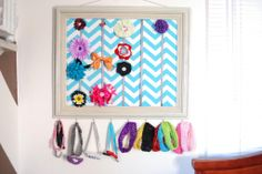 Picture frame bow holder  http://tiffanymarieellis.blogspot.com/2012/12/designing-shared-room-picture-frame-bow.html