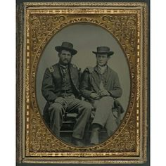 Two unidentified soldiers in Union uniforms with cigars.  LIBRARY OF CONGRESS civil war era