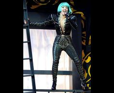 Lady Gaga hit the stage at the 22nd Annual MuchMusic Video Awards at the MuchMusic HQ on June 19, 2011 in Toronto, Canada covered in a black-feathered frock with a hint of her mint green hair peeking through.