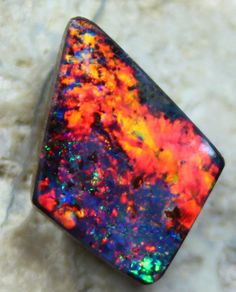 5.35 CTS BEAUTIFUL RED FIREY BOULDER OPAL COLLECTABLE
