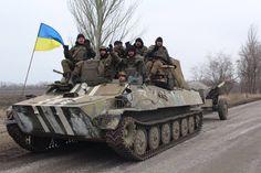 Ukrainian Army MT-LB dragging an artillery piece [1620 x 1080]