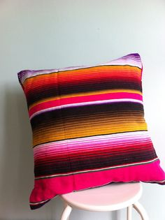 Check out our awesome Sarape-striped blankets! Available now at themexicandecor.com
