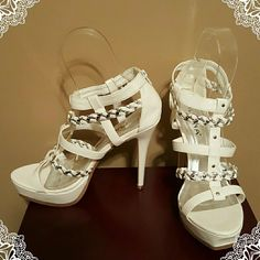 **Brand New** White/Silver Strappy Stilettos White with silver/white braid. Back Zipper. One inch platform makes these 5 inches high.  NIB. No trades on new shoes Liliana Shoes Heels