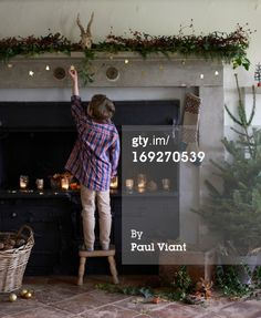 View top-quality stock photos of Boy Decorating Christmas Fireplace. Find premium, high-resolution stock photography at Getty Images. Simple Christmas, Christmas And New Year, Christmas Time, Xmas, Christmas Fireplace, Vintage Stil, Boy Photos, Wonderful Time, Royalty Free Images