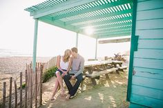 Crystal Cove, Newport Beach // turquoise gazebo + driftwood + sand engagement inspiration