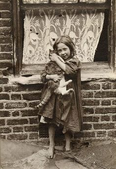"Amazing shots of East End street kids in Victorian London. A young girl cuddles with a cat. Horace Warner took these pictures of the children he called ""Spitalfields nippers"", each one as bursting with character as the last."