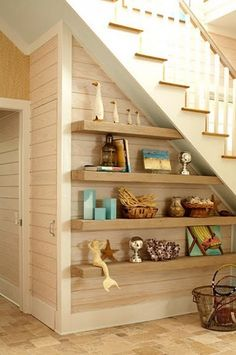 Under Stair With Wooden Shelves And Coastal Accessories Decorating Ideas For Under Stairs Check more at http://www.wearefound.com/decorating-ideas-for-under-stairs/ #coastallivingroomsstairs