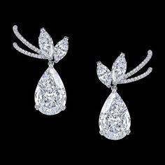 The Vault earrings by Harry Kotlar in platinum set with pear-, brilliant and marquise- cut diamonds weighing a total of 13,35 carats.
