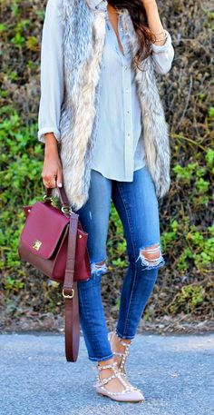 perfect fall outfit: distressed j brands, fur vest, blouse, valentino rockstud flats