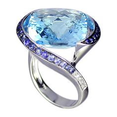 Sky blue topaz with tanzanite accent stones.