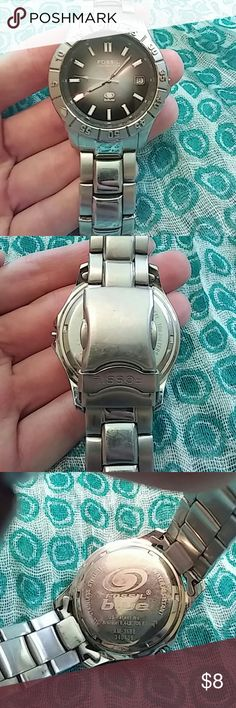 Mens Fossil Blue watch Mens Fossil Blue watch. Stainless steel, greyish- black face with date. Worn and has minor scratches but in reasonable condition. Needs a new battery. Fossil Accessories